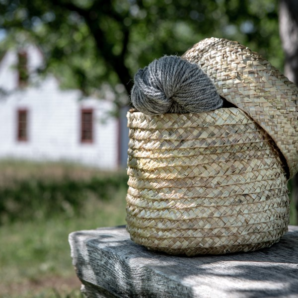 A skein of wool, wound by Madame Robichaud and set into Madame Babineau's handmade straw basket